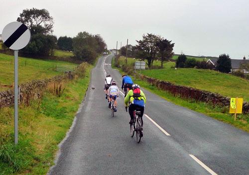 4-cyclists-lancashire-rain