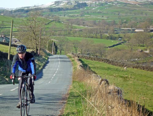 cyclist-climbing-burnsall-fell