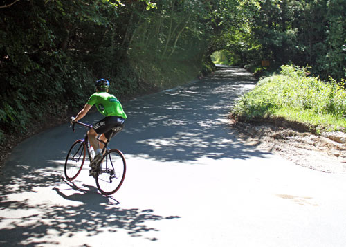 This is a hairpin on Box Hill. The rider is taking a wide route.