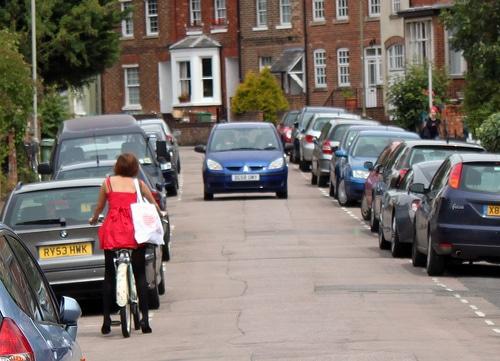 waiting-narrow-road-parked-cars