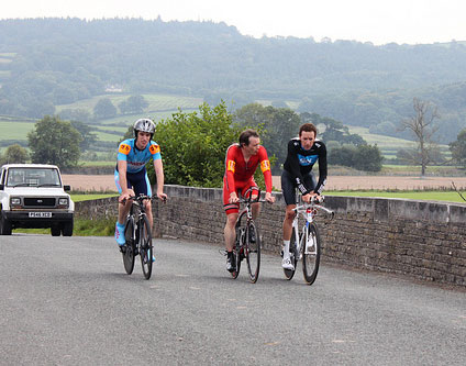 Wiggins, Hutchinson and an unknown club cyclist riding together.