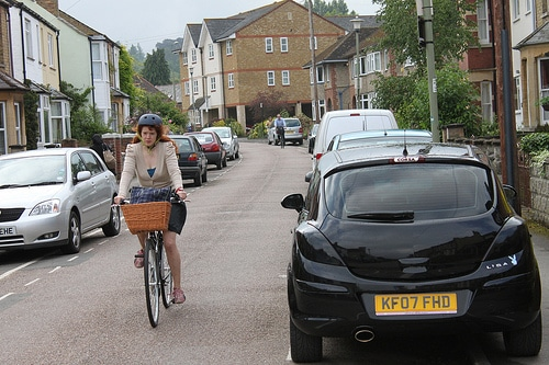 cyclist-parked-cars-either-side