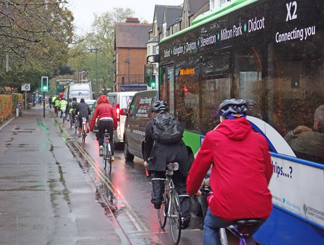 line-of-cyclists-iffley-road-wet