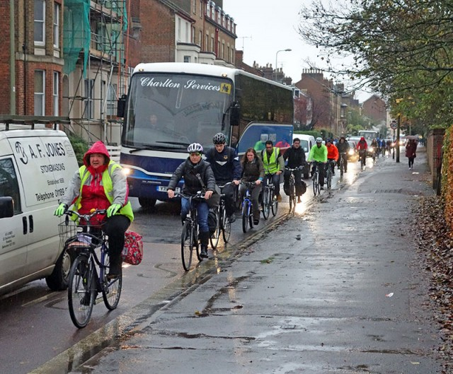 line-of-wet-cyclists