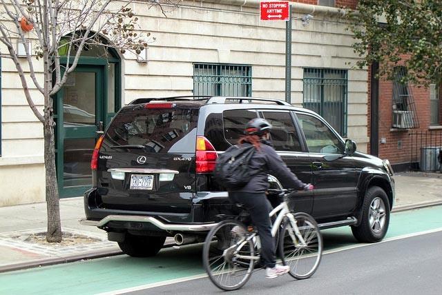 car-parked-ny-lane