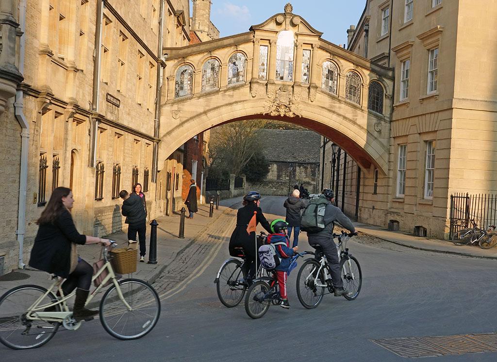 cycling-under-bridge-sighs